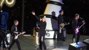 Cloak and dagger: Midnight Oil performing in their Sorry suits at the Sydney Olympics closing ceremony. Picture: Nathan EdwardsSource:News Corp Australia